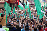 Palestinians take part in a rally on 10th anniversary of prisoners swap deal between Hamas and Israel, in Jabalia in the northern Gaza strip on October 15, 2021. October will mark a decade since the last major swap deal between Israel and Hamas, in which Israel released over 1,000 prisoners in exchange for soldier Gilad Shalit, who spent five years in captivity. Photo by Ashraf Amra
