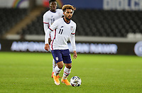 SWANSEA, WALES - NOVEMBER 12: Konrad De la Fuente #11 of the United States looks for an open man during a game between Wales and USMNT at Liberty Stadium on November 12, 2020 in Swansea, Wales.