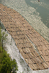 Log rafts on river, elevated view