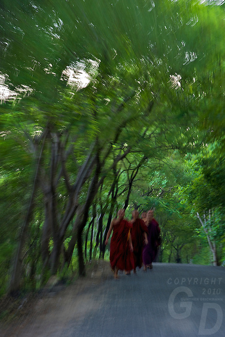 Monks on the road to Mandalay Hill Mandalay, Myanmar