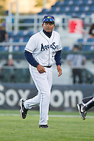 Everett AquaSox pitching coach Nasusel Cabrera #22 during a game against the Tri-City Dust Devils at Everett Memorial Stadium in Everett, Washington on July 28, 2014. Tri-City defeated Everett 6-5 in 11 innings.  (Ronnie Allen/Four Seam Images)