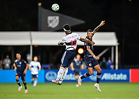 LAKE BUENA VISTA, FL - JULY 26: Khiry Shelton of Sporting KC challenges Derek Cornelius of Vancouver Whitecaps FC for a header during a game between Vancouver Whitecaps and Sporting Kansas City at ESPN Wide World of Sports on July 26, 2020 in Lake Buena Vista, Florida.