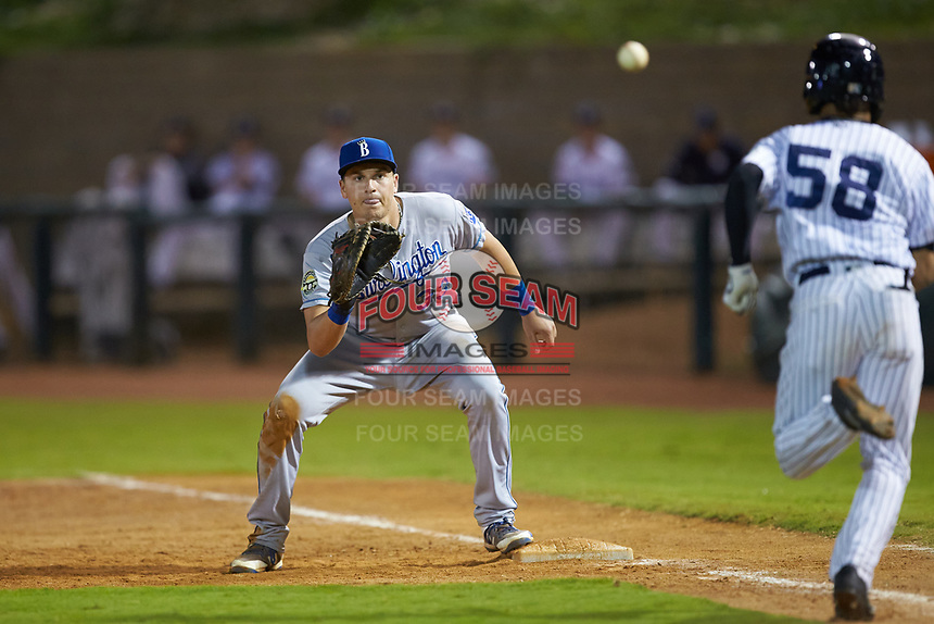 Burlington Royals first baseman Vinnie Pasquantino (33) waits for a throw as Madison Santos (58) of the Pulaski Yankees hustles down the line at Calfee Park on September 1, 2019 in Pulaski, Virginia. The Royals defeated the Yankees 5-4 in 17 innings. (Brian Westerholt/Four Seam Images)