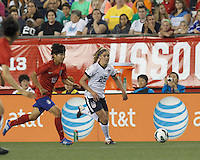 USWNT substitute midfielder Morgan Brian (25) dribbles down the wing. In an international friendly, the U.S. Women's National Team (USWNT) (white/blue) defeated Korea Republic (South Korea) (red/blue), 4-1, at Gillette Stadium on June 15, 2013.