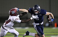 Peyton McKee (6) of Springdale Har-ber runs the ball as Zamarion Manuel (34) of Springdale looks to make tackle on Friday, Oct. 8, 2021, during the first half of play at Wildcat Stadium in Springdale. Visit nwaonline.com/211009Daily/ for today's photo gallery.<br /> (Special to the NWA Democrat-Gazette/David Beach)