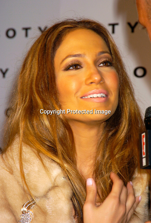 Jennifer Lopez ..at Coty's 100th Anniversary Celebration  on September 12, 2004 at the  American Museum of Natural Historys Rose Center for Earth and Space ..Photo by Robin Platzer, Twin Images