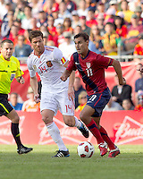 USA forward Chris Wondolowski (11) dribbles as Spain midfielder Xabi Alonso (14) closes. In a friendly match, Spain defeated USA, 4-0, at Gillette Stadium on June 4, 2011.