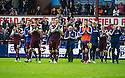 Hearts' players do a lap of honour at the end of the game.