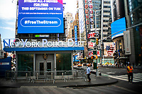 """NEW YORK, NEW YORK - SEPTEMBER 3: People walk near NYPD unit at Times Square on September 3, 2020 in New York.  U.S. President Trump has ordered to the federal government to begin the process to defund NYC and three other cities where protest """"lawless"""" were allowed and police budgets were cut, rising violent crime. (Photo by Eduardo MunozAlvarez/VIEWpress via GettyImages)"""