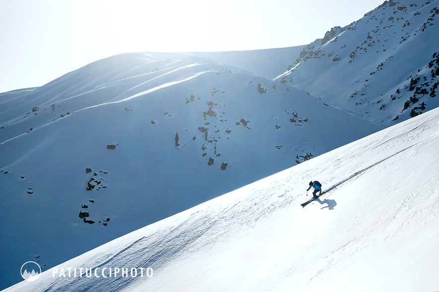 Skiing in the wide open landscape at the Too Ashu Pass area of Kyrgyzstan