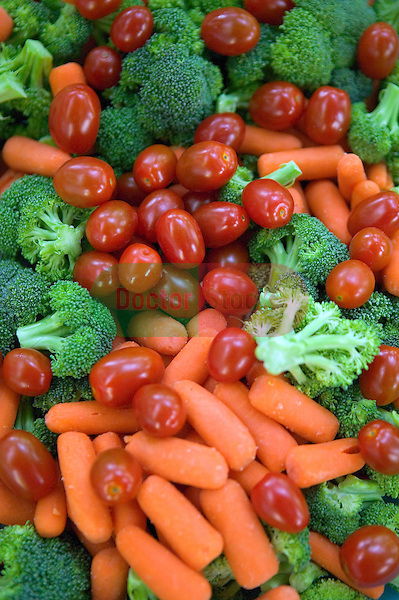 baby tomatoes, broccoli, and carrots mixed to gather and ready for dipping and eating