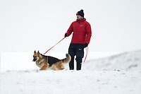 Pictured: A dog Walker in the snow at Libanus, in Brecon, Wales, UK. Friday 01 February 2019<br /> Re: Heavy snow and freezing temperatures affecting parts of the UK.