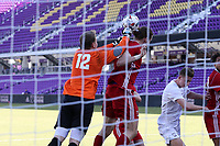 Orlando, Florida - Wednesday January 17, 2018: Jeff Caldwell punches the ball off of the head of Markus Fjortoft. Match Day 3 of the 2018 adidas MLS Player Combine was held Orlando City Stadium.
