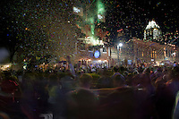 Thousands of party goers toast the official New Year's Eve Countdown and Ball Drop on 6th Street in downtown Austin, Texas.