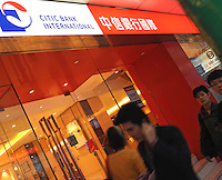 Pedestrians walk by the Citic Bank International, one of the branches situated in Central, Hong Kong, China. Citic BankInternational is a Hong Kong-based full-service commercial bank that offers a broad spectrum of financial services to both local and overseas customers..