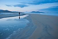 Reflection of person walking on Luskentyre beach, Isle of Harris, Western Isles, Scotland