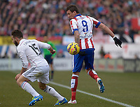 MADRID (SPAIN), FEBRUARY, 7, 2015. Mandzukic of Atlético de Madrid fights for the ball with Carvajal of Real Madrid during the football match of Atlético de Madrid vs Real Madrid at Vicente Calderón stadium for Spanish Soccer League 2014-2015 . PATRICIO REALPE/ASNERP