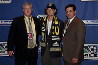 Columbus Crew Head Coach Sigi Schmid, fourth round draft pick Aaron Chandler, and General Manager Mark McCullers during the MLS SuperDraft at the Indiana Convention Center, Indianapolis, IA, on Jan 12, 2007.