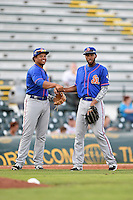 St. Lucie Mets third baseman Jhoan Urena (13) and shortstop Amed Rosario (11) in between innings during a game against the Bradenton Marauders on April 11, 2015 at McKechnie Field in Bradenton, Florida.  St. Lucie defeated Bradenton 3-2.  (Mike Janes/Four Seam Images)