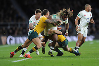Marland Yarde of England is tackled by Quade Cooper of Australia during the Old Mutual Wealth Series match between England and Australia at Twickenham Stadium on Saturday 3rd December 2016 (Photo by Rob Munro)