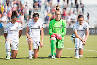 CARY, NC - SEPTEMBER 12: Sophia Smith #9, Emily Menges #5, Bella Bixby #31, and Christine Sinclair #12 of the Portland Thorns kneel during the national anthem before a game between Portland Thorns FC and North Carolina Courage at WakeMed Soccer Park on September 12, 2021 in Cary, North Carolina.
