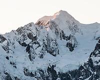 Sunrise on second highest peaks of Southern Alps Mount Tasman, Westland Tai Poutini National Park, UNESCO World Heritage Area, West Coast, New Zealand, NZ