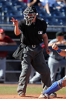 Home plate umpire Chris Segal during an Arizona Fall League game between the Peoria Javelinas and Salt River Rafters at Peoria Sports Complex on November 2, 2011 in Peoria, Arizona.  Peoria defeated Salt River 4-2.  (Mike Janes/Four Seam Images)