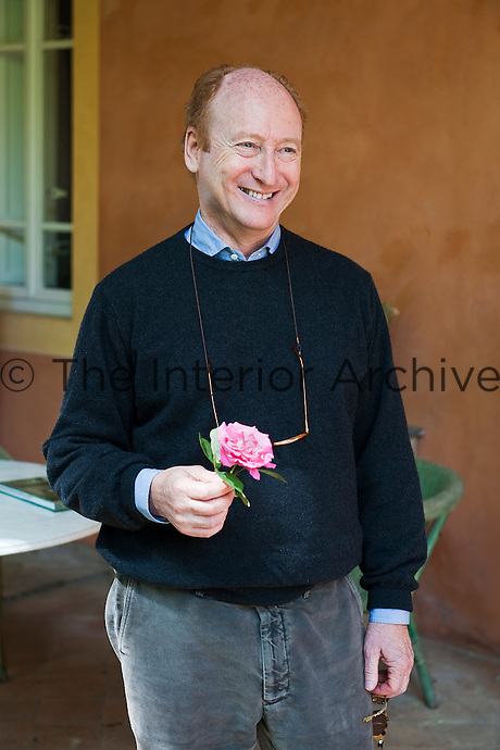 A smiling Gil Cohen photographed on the terrace of the villa