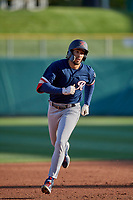 Dillon Thomas (20) of the Tacoma Rainiers circles the bases against the Salt Lake Bees at Smith's Ballpark on May 13, 2021 in Salt Lake City, Utah. The Rainiers defeated the Bees 15-5. (Stephen Smith/Four Seam Images)
