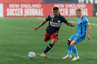 FOXBOROUGH, MA - SEPTEMBER 02: Brandon Bye #15 of New England Revolution passes the ball as Alexander Ring #8 of New York City FC defends during a game between New York City FC and New England Revolution at Gillette Stadium on September 02, 2020 in Foxborough, Massachusetts.