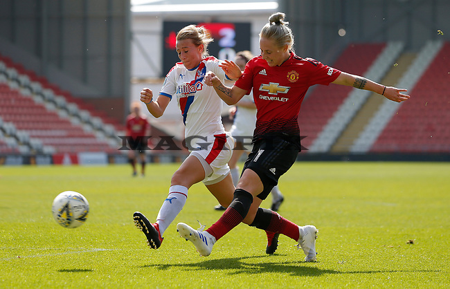 Leah Galton of Manchester United Women puts the ball in the net for the 3rd goal