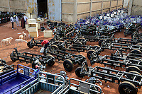 BURKINA FASO, Bobo Dioulasso, warehouse for chinese tricycle for rural transport / BURKINA FASO, Bobo Dioulasso, Firma vertreibt chinesisches Lastendreirad der Marken Apsonic, Apollo und Haojin