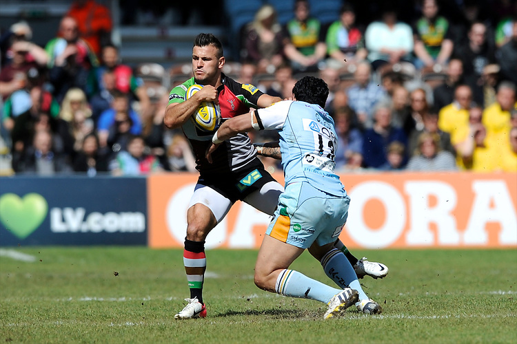 Danny Care of Harlequins is tackled by George Pisi of Northampton Saints during the Aviva Premiership match between Harlequins and Northampton Saints at the Twickenham Stoop on Saturday 4th May 2013 (Photo by Rob Munro)