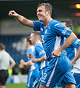 Queen of the South's Ryan McGuffie (3) celebrates after he scores their first goal.
