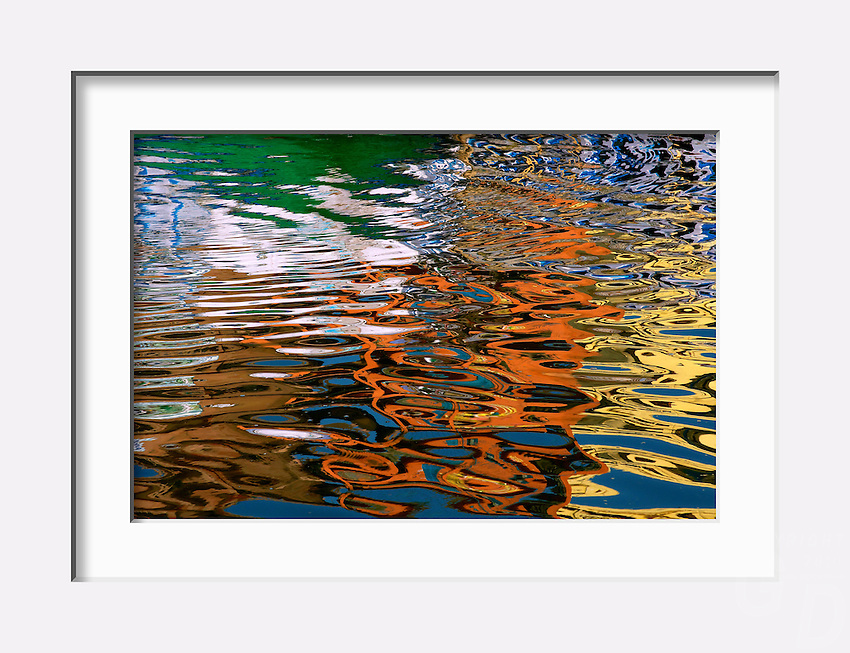 Colorful reflection on the ganges River along the Banks of Varanasi, India.