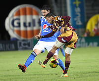 IBAGUE -COLOMBIA, 9-NOVIEMBRE-2014. Sebastian Pinto (Izq)  de Millonarios disputa el balon con  Felix Noguera  del Deportes Tolima . Partido por la fecha 18 de la Liga Postobón 2014- II , jugado en el estadio Manuel  Murillo Toro de la ciudad de Ibague./  Sebastian Pinto  of Millonarios  fights  the ball against  Felix Noguera  of Deportes Tolima. Match of  Party date 18th  2014 Postobón League II   played  Manuel Murillo Toro stadium in Ibague city.Photo / VizzorImage / Andrew Indell / Staff