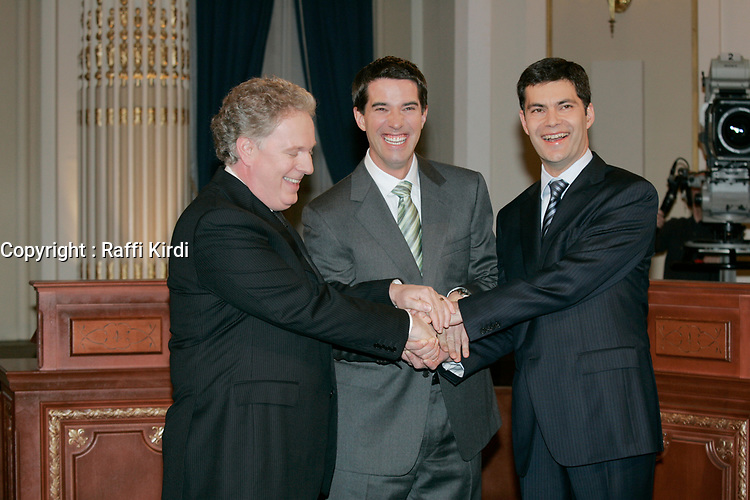 March 13, 2007 File Photo - Quebec city - CANADA - Jean Charest, Liberal leader and Quebec Premier (L), Andre Boisclair, Parti Quebecois leader (M) and Mario Dumont, Action Democratique du Quebec leader (R) pose for photographer before an electoral debate in Quebec city. Jean Charest was re-elected in the provincial election.