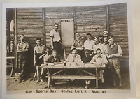 BNPS.co.uk (01202 558833)<br /> Pic: TheCotswoldAuctionCompany/BNPS<br /> <br /> Pictured: Sports Day at Stalag Luft in August 1942.<br /> <br /> A remarkable cache of rarely seen photos capturing life inside the Great Escape PoW camp has been discovered in a barn.<br /> <br /> The images, taken at Stalag Luft III in 1942 and 1943, show Allied prisoners dressed as women doing amateur-dramatics and an action-packed sports day.<br /> <br /> They donned bikinis and other extravagant outfits as they entertained their camp mates with performances of 'Aladdin' and 'Girls, Girls, Girls'.<br /> <br /> Hundreds of PoWs perched on roofs to watch the sports day which featured sprint races, the long jump, the high jump and a discus competition.