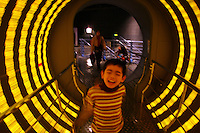 CHINA. Shanghai. A young child in a light exhibit at Shanghai Science and Technology Museum (?????; pinyin: Shàngh?i ke¯jì gu?n) is a large museum in Pudong, Shanghai, close to Century Park, the largest park of the city. The construction of the museum cost 1,75 billion RMB, and the floor area is 98 000m2 .2008..