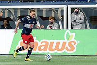 FOXBOROUGH, MA - OCTOBER 7: Alexander Buttner #28 of New England Revolution dribbles at midfield during a game between Toronto FC and New England Revolution at Gillette Stadium on October 7, 2020 in Foxborough, Massachusetts.