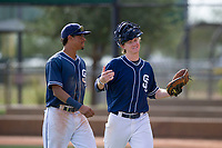 Blake Hunt (12) and Tre Carter (13) of the San Diego Padres during an Instructional League game against the Chicago White Sox on September 26, 2017 at Camelback Ranch in Glendale, Arizona. (Zachary Lucy/Four Seam Images)