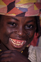 Madarounfa, Niger.  Young Hausa Girl with facial Scarification.  A piece of straw is in her nostril to hold the place for a nose ring.