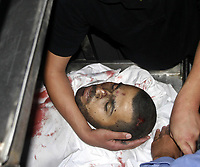 """The body of Mosaab al-Jaber during his funeral in Jabalia refugee camp in the northern Gaza Strip, 26 November 2007. Israeli troops killed three Palestinians and wounded four today in two separate incidents in the north of the Hamas-run Gaza Strip, medics and the army said.  (photo by Fady Adwan"""""""