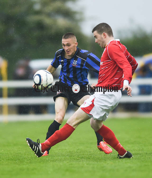 Mike Mc Namara of Bridge United in action against David O Grady of Newmarket Celtic during their Cup final at Doora. Photograph by John Kelly.