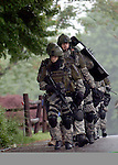 SWAT team members walk away from the home on Maple Avenue in Windsor Locks, Conn., on Wednesday, June 6, 2008, after a report of shots fired at the dwelling. (Irena Pastorello/Journal Inquirer)
