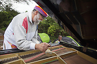 """Ethiopia. Southern Nations, Nationalities, and Peoples' Region. Karat village. Konso tribe. Robert Wolken is a professional piano tuner and takes care of Marc Vella's Yamaha Grand Piano. Marc Vella is a french musician and a nomadic pianist. Over the last 25 years he has travelled with his piano in around forty countries to celebrate humanity. Creator of """"La Caravane amoureuse"""" (The Caravan of Love) he takes people with him to say """"I love you"""" to others and """"lovingly conquered"""" their hearts and souls. Piano tuning is the act of making minute adjustments to the tensions of the strings of an acoustic piano to properly align the intervals between their tones so that the instrument is in tune. The Konso, also known as the Konzo, are a Cushitic-speaking ethnic group. Although the Konso people have many customs dating back hundreds of years, it is not uncommon for them to be seen wearing western clothing. The Omo Valley, situated in Africa's Great Rift Valley, is home to an estimated 250,000 individuals of the Konso tribe. Southern Nations, Nationalities, and Peoples' Region (often abbreviated as SNNPR) is one of the nine ethnic divisions of Ethiopia 7.11.15 © 2015 Didier Ruef"""