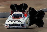 Apr 9, 2006; Las Vegas, NV, USA; NHRA Funny Car driver John Force slows to a stop during eliminations at the Summitracing.com Nationals at Las Vegas Motor Speedway in Las Vegas, NV. Mandatory Credit: Mark J. Rebilas