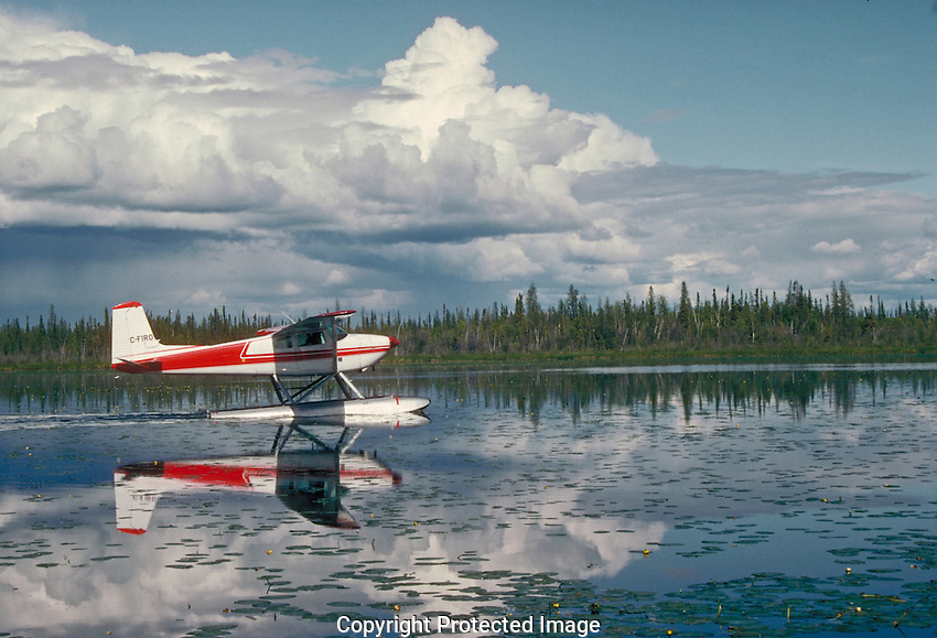 Small float plane prepares to take off from Loon lake near Fort Smith