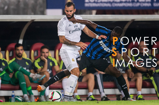 (L) Jese Rodriguez of Real Madrid CF competes for the ball with (R) Geoffrey Kondogbia of FC Internazionale Milano during the FC Internazionale Milano vs Real Madrid  as part of the International Champions Cup 2015 at the Tianhe Sports Centre on 27 July 2015 in Guangzhou, China. Photo by Aitor Alcalde / Power Sport Images