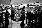 MIDDLETOWN, PA — SEPTEMBER 26, 2020:  A Q-Anon flag is displayed at a booth at a rally for President Donald Trump during the Covid-19 pandemic at the Harrisburg International Airport on September 25, 2020 in Middletown, PA.  Thousands of attendees, most of whom were maskless, rode on shuttle busses to and from the long term parking lot and the event site— as the world nears one million Covid-19 deaths— defying the states ban on gatherings over 250 people.  Photograph by Michael Nagle